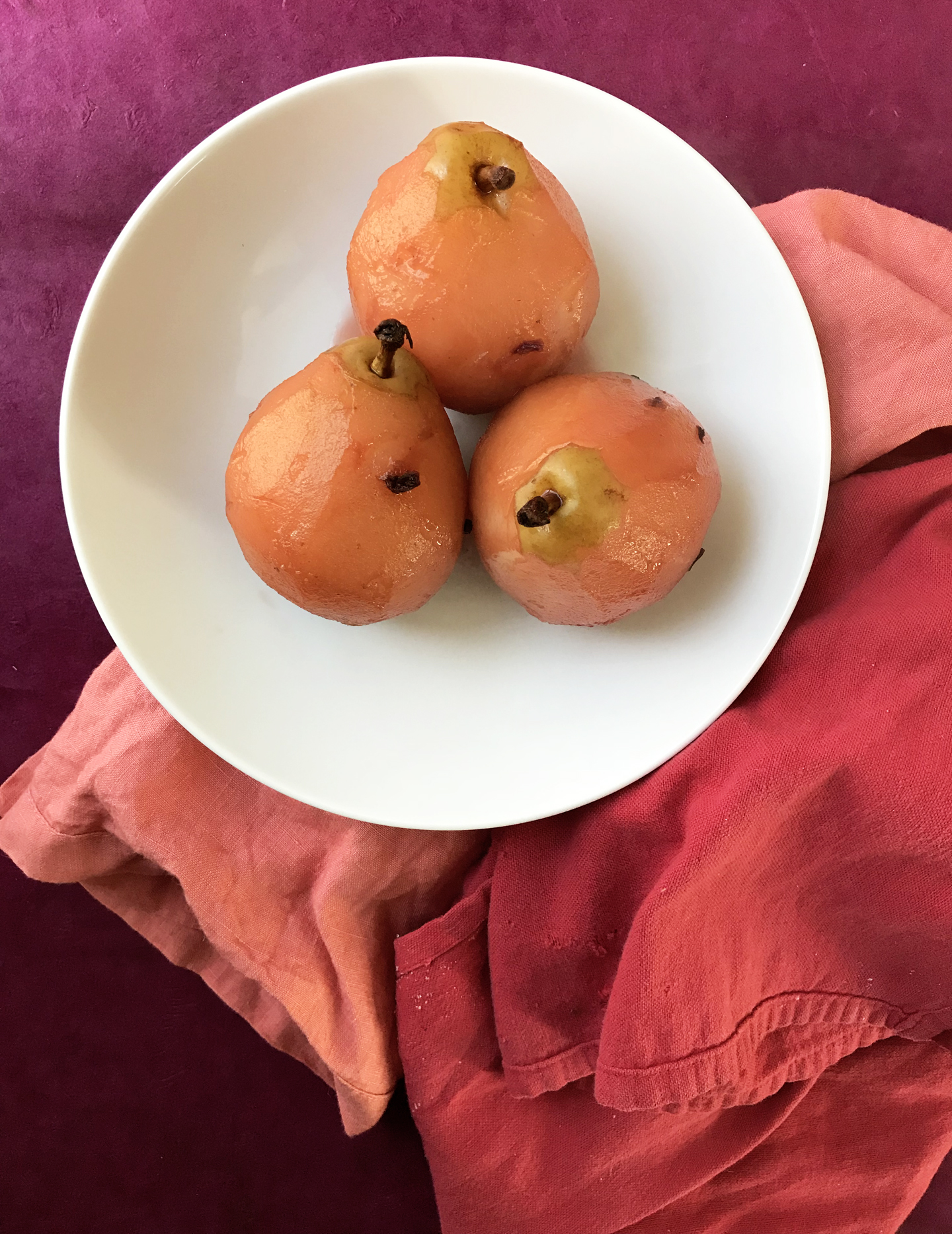 Pears Poached in Pomegranate Molasses with Ginger & Hibiscus
